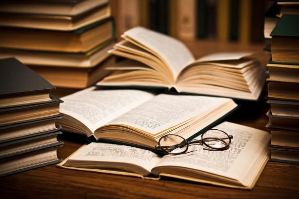 bigstock-opened-book-lying-on-the-book-12763865